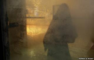 Between illusion and reality...is where I stand, by Marwah Al-Mugait