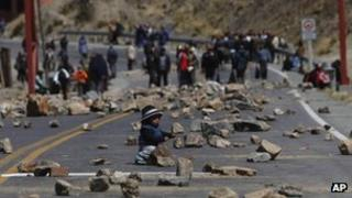 A miner's son plays on a road leading to La Paz on 11 September 2012