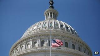 The American flag stands at half-staff at the US Capitol in memory of the US ambassador to Libya killed in Benghazi