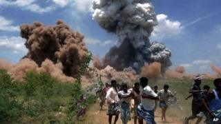 People run away from the fire in the factory in Sivakasi on September 5