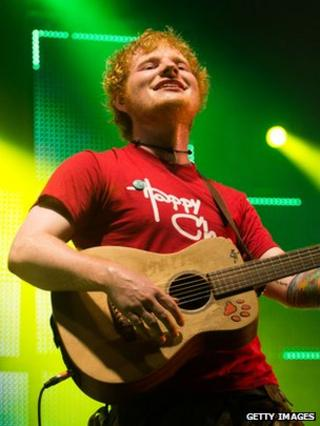Ed Sheeran performing at V Festival
