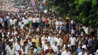 Indian activists of the Trinamool Congress (TMC) with the chief minister of the eastern Indian state of West Bengal Mamta Banerjee (unseen) march during a demonstration against the foreign direct investment (FDI) in multi-brand retail in Kolkata on September 15, 2012.