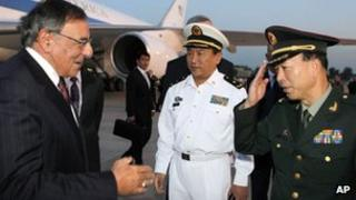 US Secretary of Defence Leon Panetta (L) is welcomed by Chinese military leaders after his arrival in Beijing (17 September)