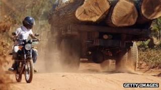 Motorcyclist and logging truck