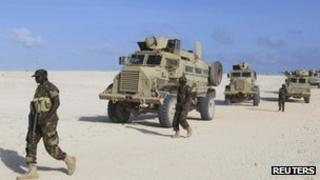 Peacekeepers from the African Union Mission in Somalia patrol after capturing the Elmaan seaport from al Shabab insurgents September 4, 2012