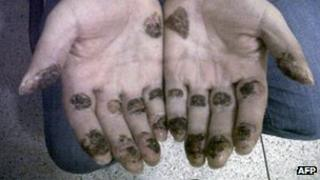Picture of the hands of Daniel Barrera released by Colombian police on 19 September 2012