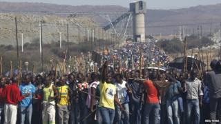 Mine workers take part in a march at Lonmin's Marikana mine in South Africa's North West Province on 10 September 2012
