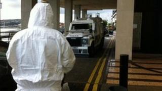 Forensic officer at bomb scene