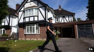 Police guard family home in Claygate