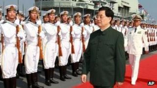 Chinese President Hu Jintao inspects the guard of honour on the aircraft carrier Liaoning at the port of Dalian, 25 Sept 2012