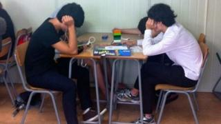 Students playing board game in class