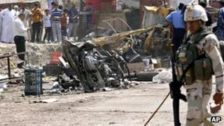 Security forces inspect the scene of a car bomb attack in Basra, 9 September 2012