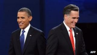 US President Barack Obama and Mitt Romney finish their debate at the University of Denver in Denver, Colorado, 3 October 2012