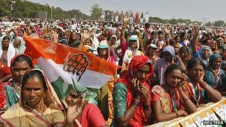"""Supporters of India""""s ruling Congress party listen to the speech by party chief Sonia Gandhi during an election campaign rally ahead of state assembly elections at Rajkot, in the western Indian state of Gujarat October 3, 2012"""