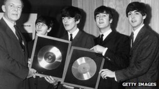 The Beatles being presented with gold discs