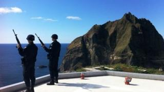 Armed South Korean policemen stand on guard on the disputed Dokdo/Takeshima islands, 04 Oct 2012