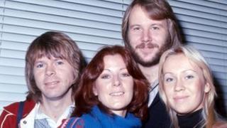 Agnetha Faltskog (left) with other member of Abba