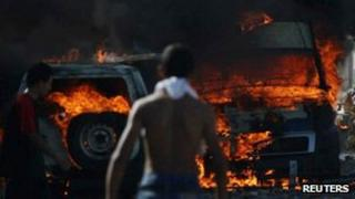 Police cars burn in Guellala. 6 Oct 2012