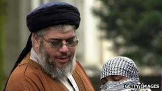 Abu Hamza Al-Masri is embraced by one of his supporters outside the Finsbury Park Mosque during Friday prayers 21 March 2003
