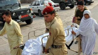 Soldiers carry Malala Yousafzai, 14, at an army hospital following the attack