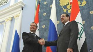 Russian Prime Minister Dmitry Medvedev shake hands with Iraq's Prime Minister Nouri Al-Maliki (R) outside Moscow on 9 October 2012