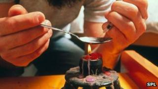 A heroin user prepares a fix