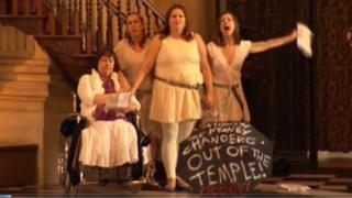Protesters chained to the pulpit balustrade