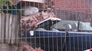 Car embedded in house, Norfolk