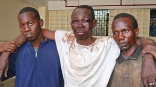 Separatist Mombasa Republican Council (MRC) Chairman, Omar Mwamnuadzi (C) is pictured after his arrest by the police at his house in Kombani, Kwale county, 40 kilometres (25 miles) south of the port city Mombasa on October 15, 2012