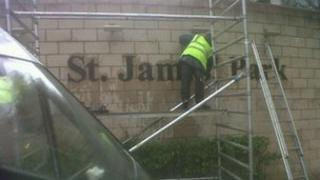 The St James' Park signs being put back up at the stadium