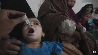 A Pakistani medic gives a polio vaccine to a child in Peshawar, Pakistan, Monday, Sept. 10, 2012