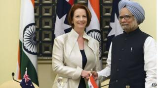 Australian Prime Minister Julia Gillard, left, shakes hands with Indian Prime Minister Manmohan Singh after a meeting in New Delhi, India, Wednesday, Oct. 17, 2012. (