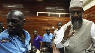 Kenyan Member of Parliament Sheikh Mohammed Dor (R) is escorted to the court cells after denying incitement charges levelled against him when he addressed supporters of separatist Muslim Mombasa Republican Council (MRC), in the coastal port city Mombasa October 18, 2012.