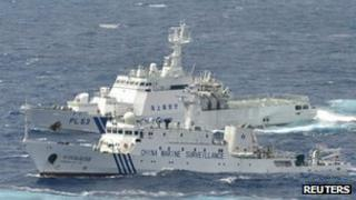 A Chinese marine surveillance ship cruises next to a Japan Coast Guard patrol ship in the East China Sea, file pic from 24 September 2012