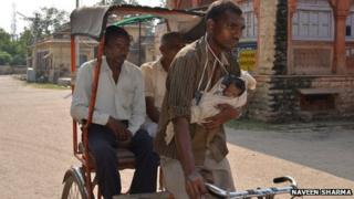 The rickshaw puller with his daughter