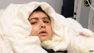 Malala Yousafzai lying in her bed after receiving treatment at the Queen Elizabeth Hospital/University Hospitals in Birmingham
