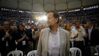 Spanish prime minister and PP leader Mariano Rajoy arrives at a campaign meeting for the upcoming regional elections in Galicia in Pontevedra, northwestern Spain, on October 6, 2012
