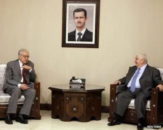 Peace envoy Lakhdar Brahimi (left) meets Syrian Foreign Minister Walid Muallem in Damascus, 20 October