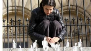 One of the volunteers places a small ice figure on the steps of Custom House Square in Belfast