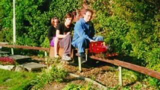 A 1990s photo of Harold Barton's son, Alec, and grandchildren on the train