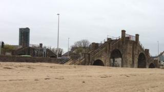 The abutments of the bridge remain but are closed off to the public