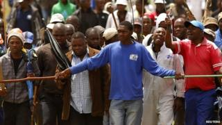 Striking miners chant slogans as they gather at the AngloGold Ashanti mine in Carletonville, north-west of Johannesburg 24 October, 2012