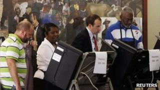US voters at an early polling station in Washington DC 24 October 2012