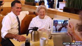 Mitt Romney sits with patrons at First Watch Cafe on 25 October 2012 in Cincinnati, Ohio