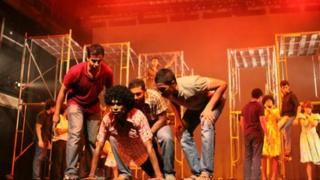 Raggers surround their victim in the musical, Rag
