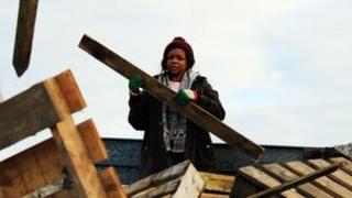 Volunteer building a community bonfire
