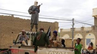 File picture dated August 2012 of fighters from Islamist group Ansar Dine standing guard in Timbuktu, Mali