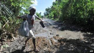 Child walks through damaged fields in Leogane - 27 October