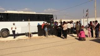 A bus prepares to leave the Zaatari Refugee Camp