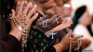 Women holding rosaries